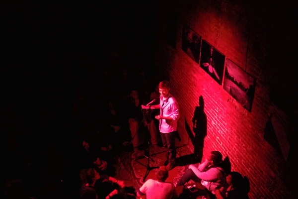 Adam Faulkner performing at Nuyorican Poets Café in New York City. Photo courtesy of Nick Gulotta.